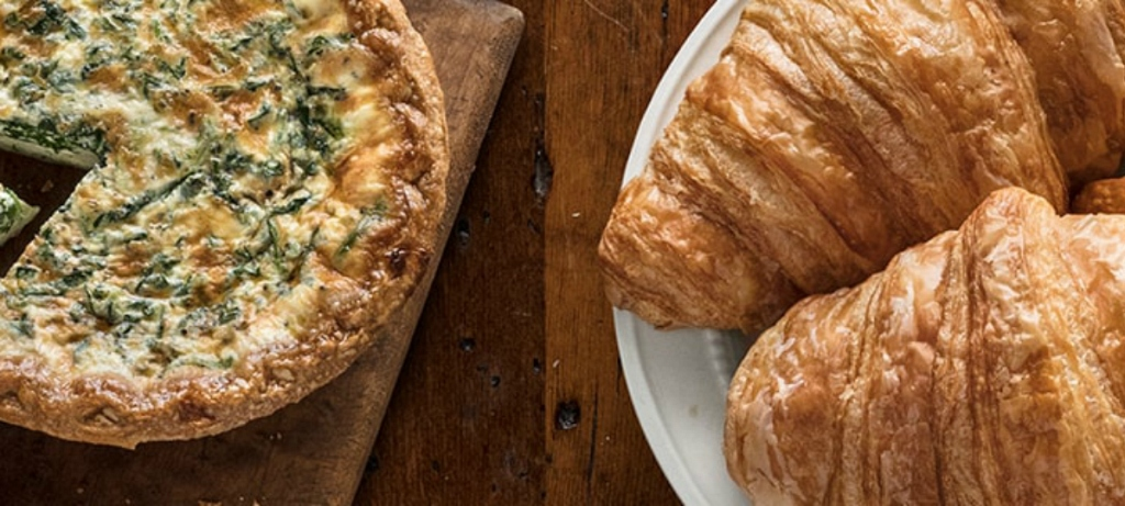 mother's day restaurant special from la madeleine of quiche and croissants on table
