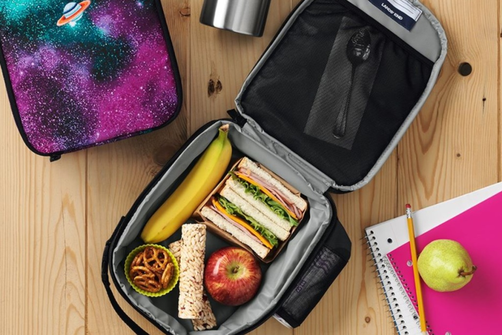 lands end lunchbox opened on table with food in it