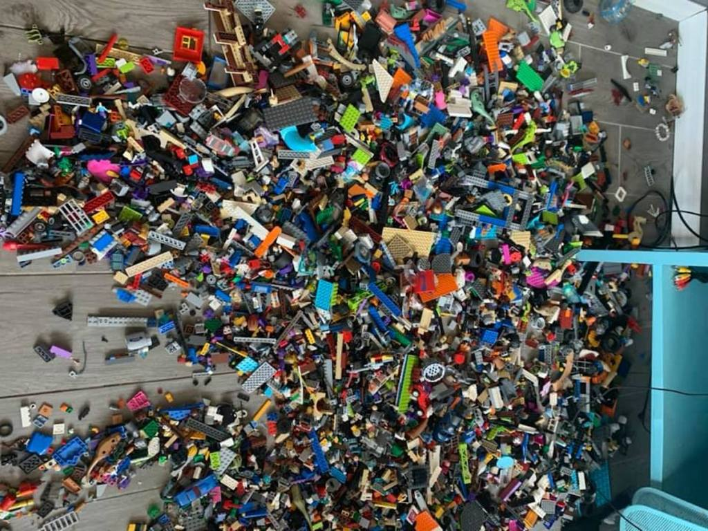 tons of various colored legos dumped on ground