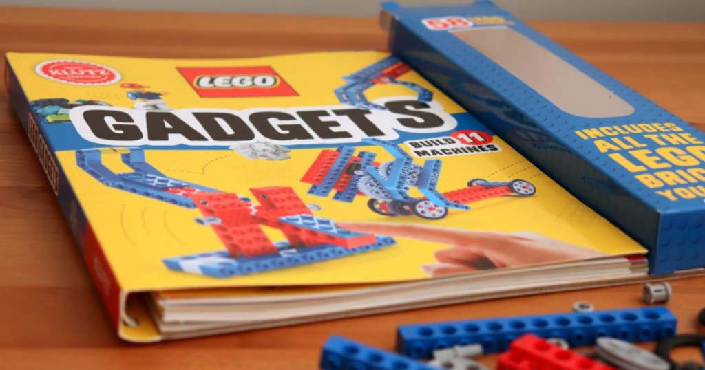 lego gadgets klutz book on table with lego pieces around it