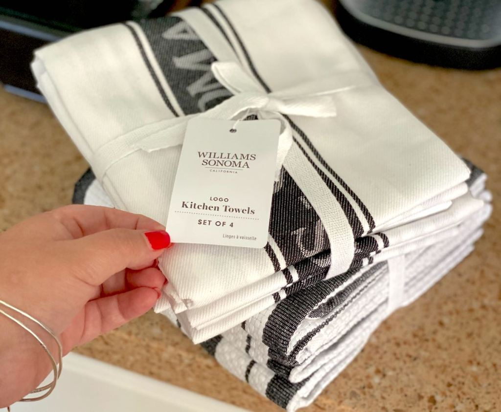 hand holding tag on new black and white towels