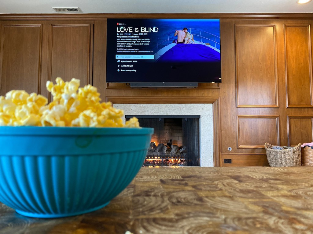 love is blind on TV screen with popcorn in bowl