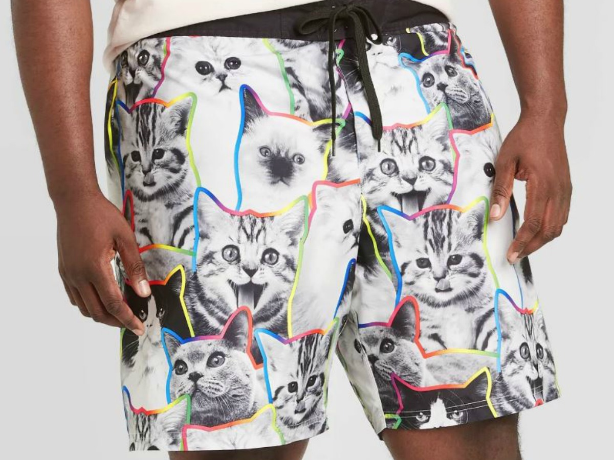 man wearing shorts with cats as the pattern