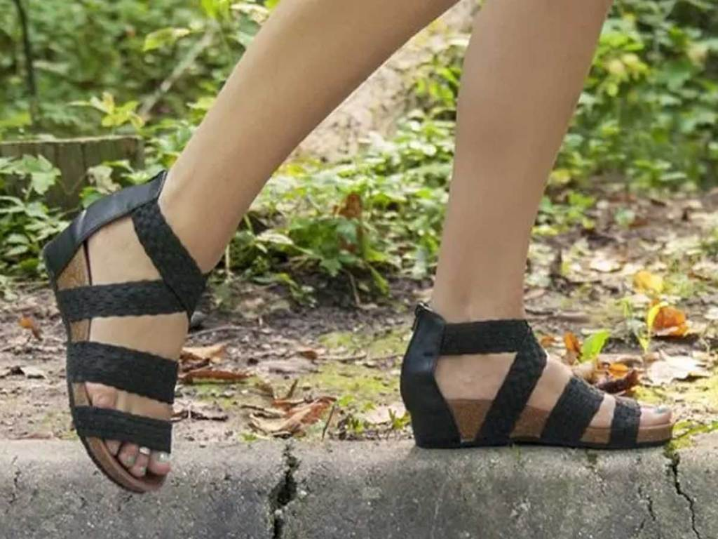woman wearing wedge sandals in an outdoor scene