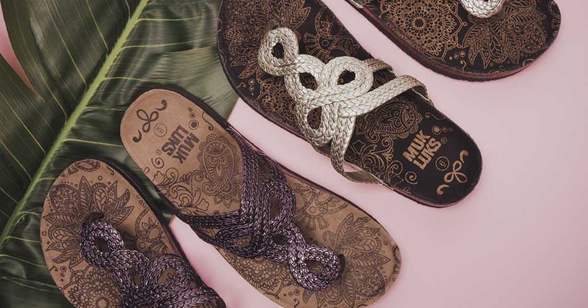 Muk Luks Betsy Sandals in brown and white stock image