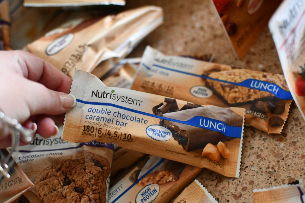 person holding protein bars