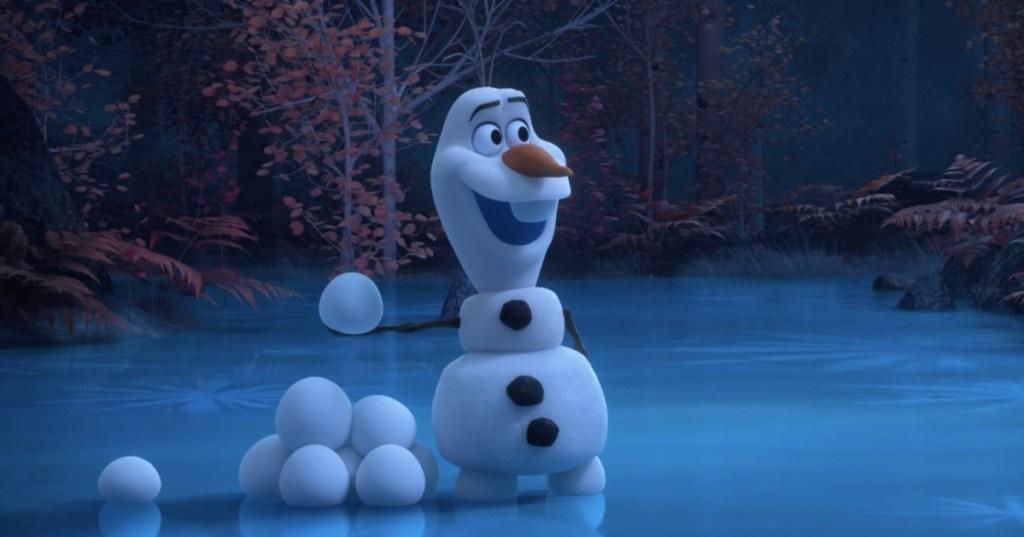 Olaf holding a snowball