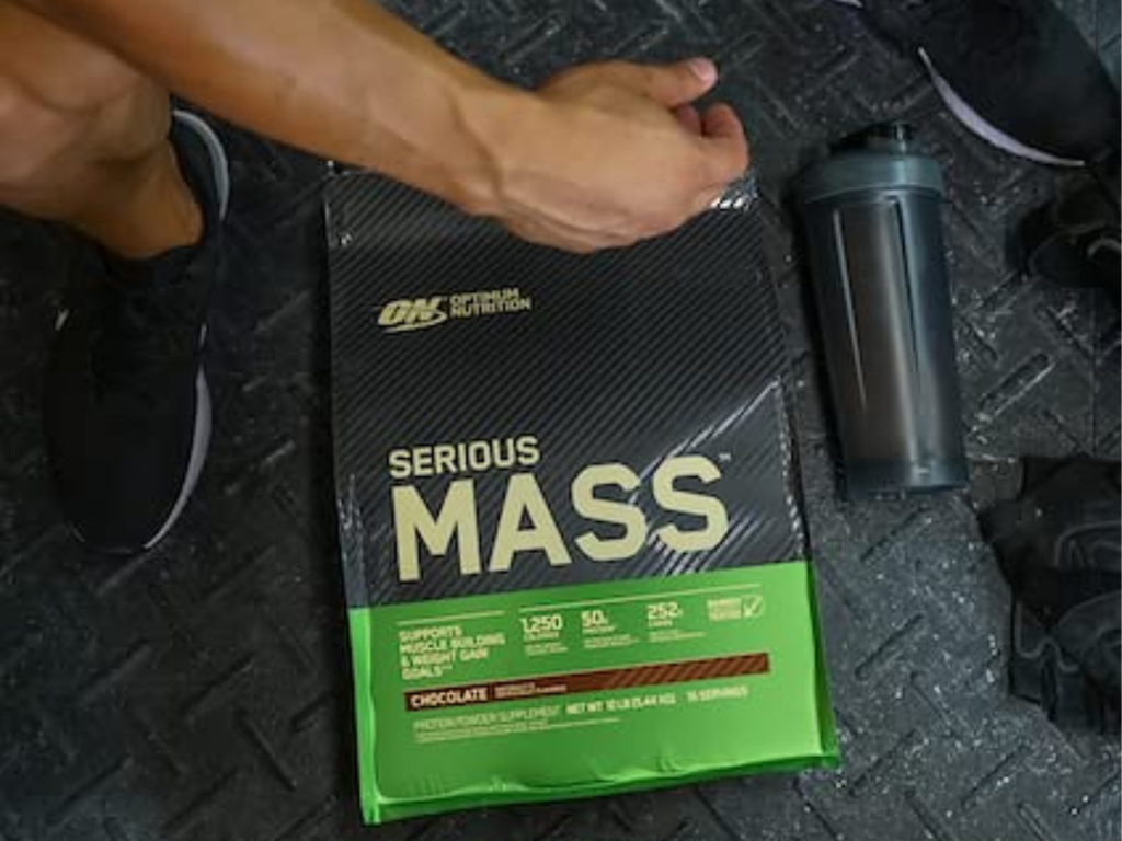 optimum nutrition serious mass package on gym floor