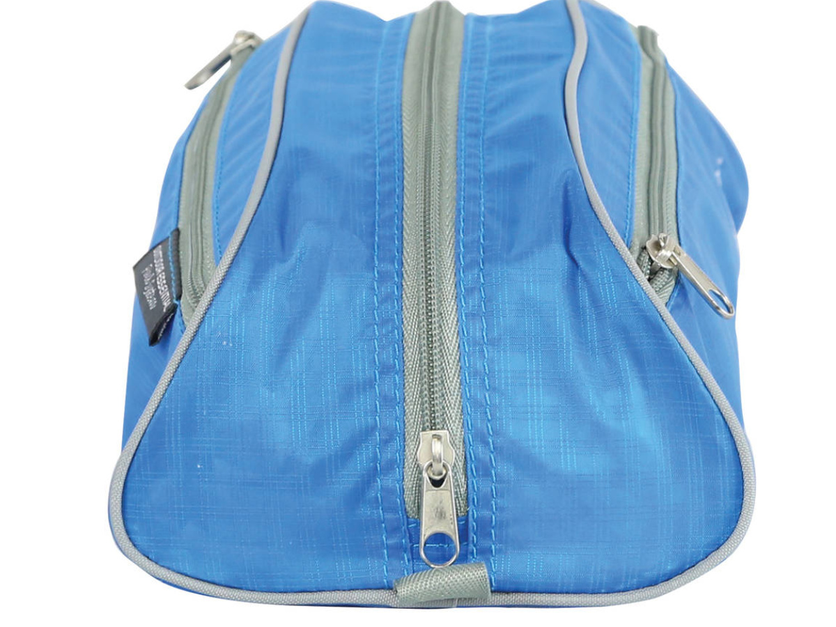 side view of blue ozark pack with zippered front and sides