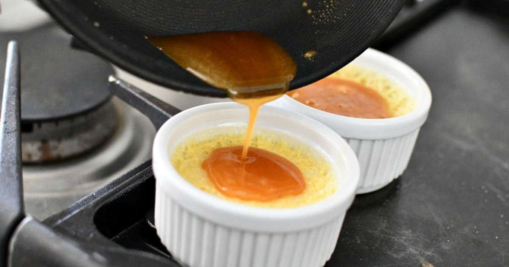 pouring sugar on top of creme brulee