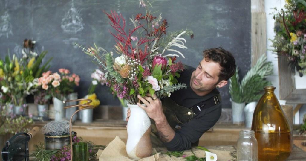 man preparing flower bouquet