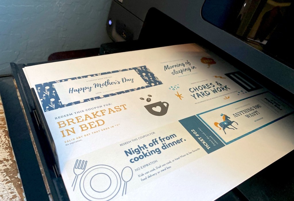 printer with sheet of mother's day coupons