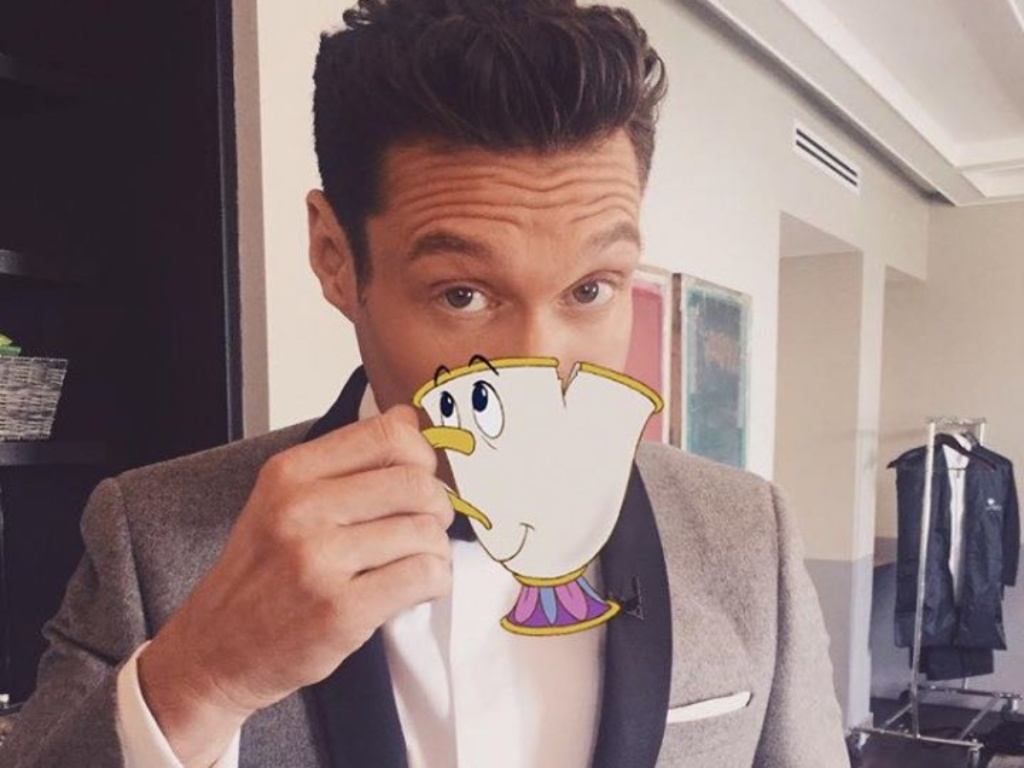 Ryan Seacrest drinking from animated cup
