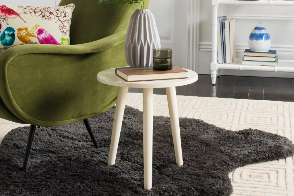 safaveih accent table in bedroom next to green chair