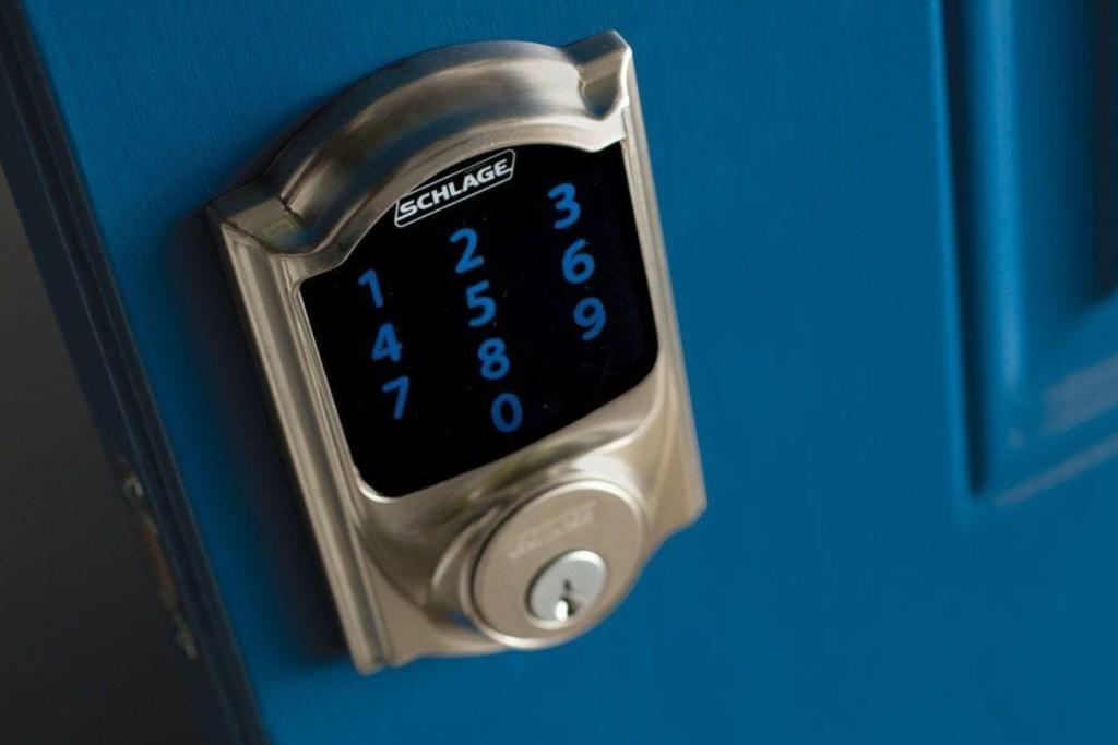 schlage lock with alarm on blue door