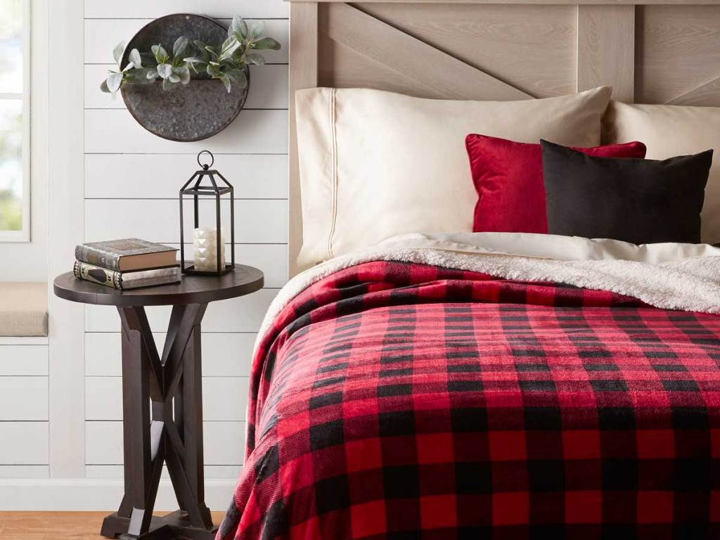 Red Plaid sherpa blanket on bed