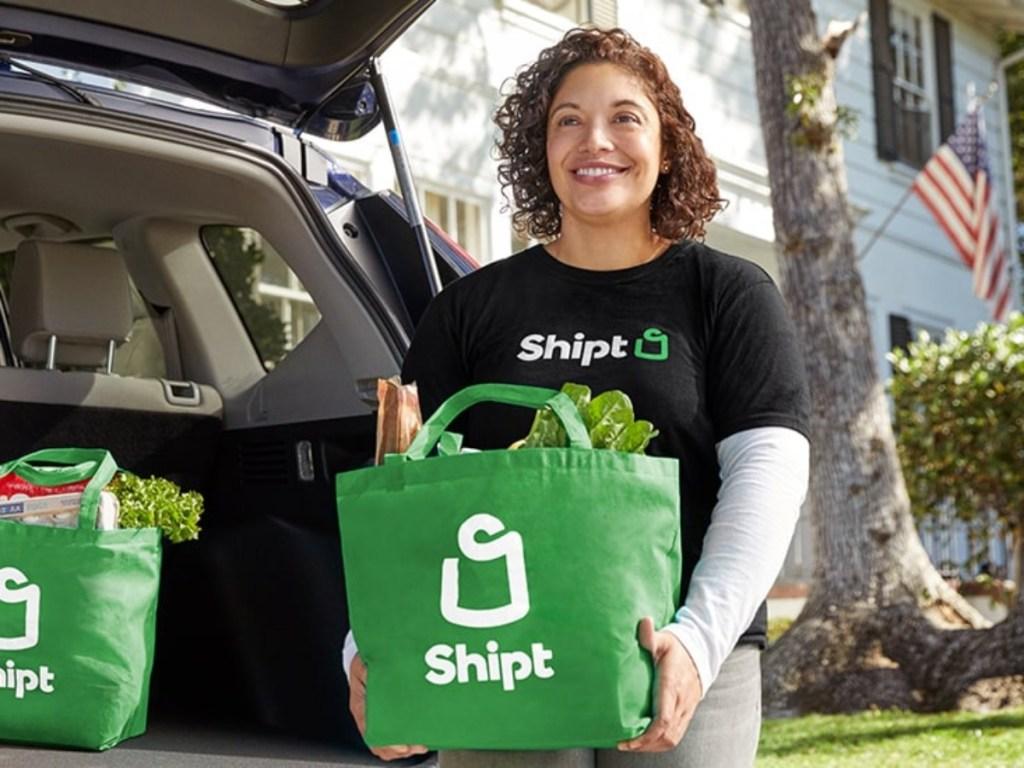 woman carrying Shipt shopping bag