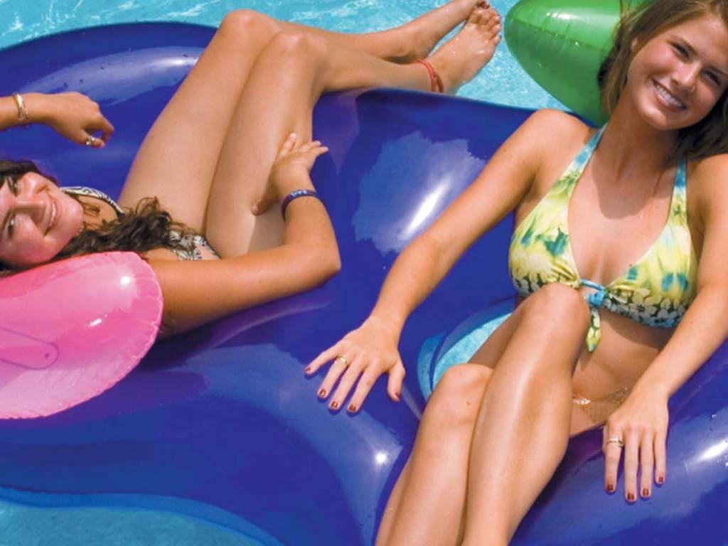 twol girls laying on a Swimline Side-by-Side Lounge Float