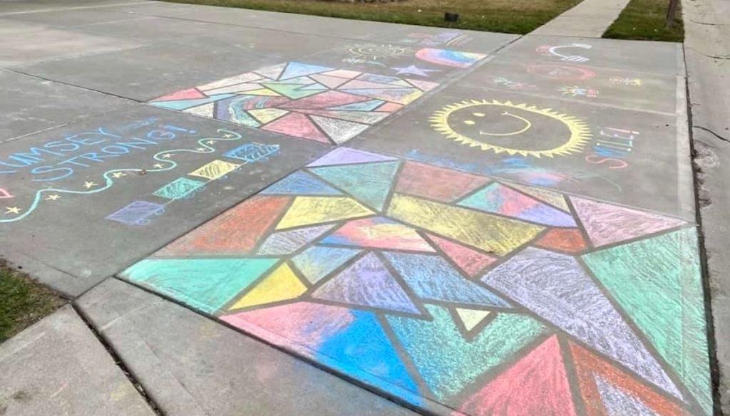 different artwork on sidewalk with chalk