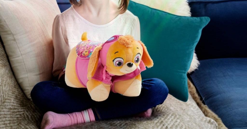 girl holding sky pillow pet