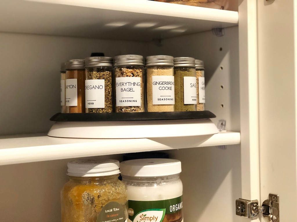spices on lazy susan in cabinet on shelf
