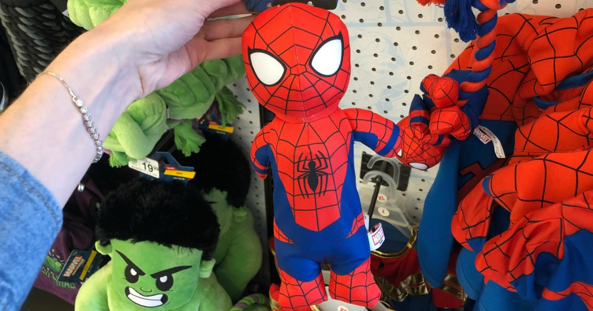 hand holding spiderman dog toy