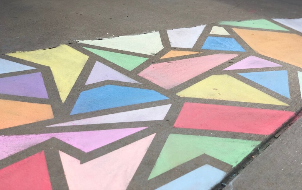 bright colors of chalk on sidewalk