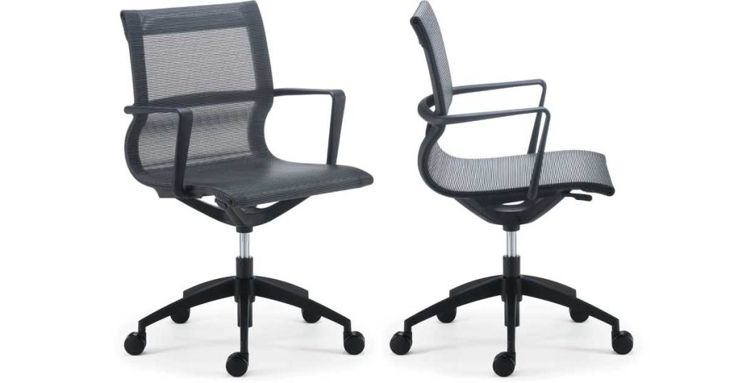 office chair mesh back and rollers stock image