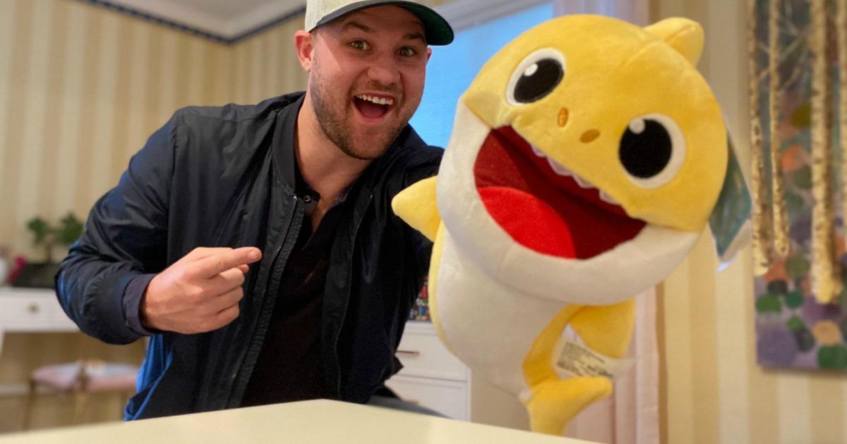 man holding a yellow baby shark puppet