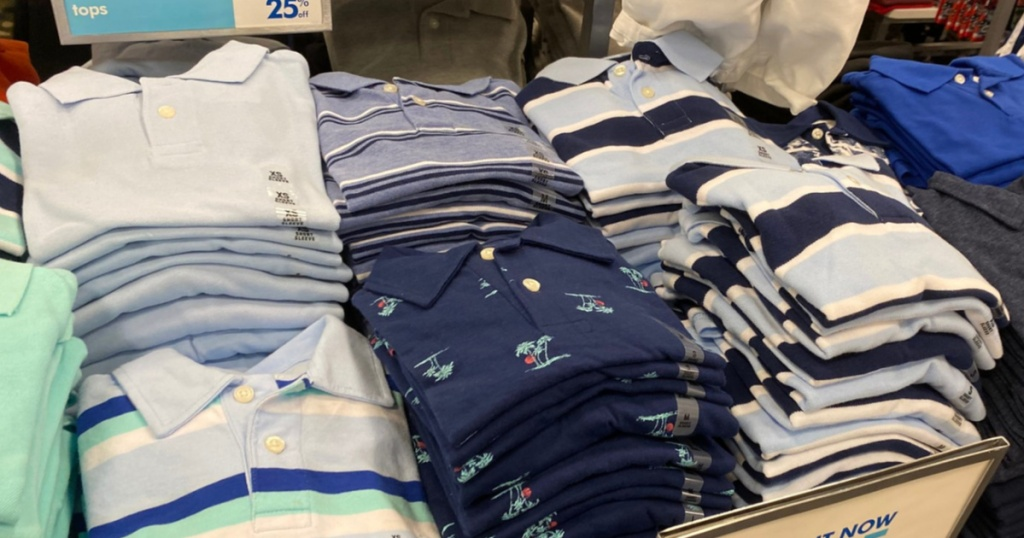 boys polos blues and greens on display in store