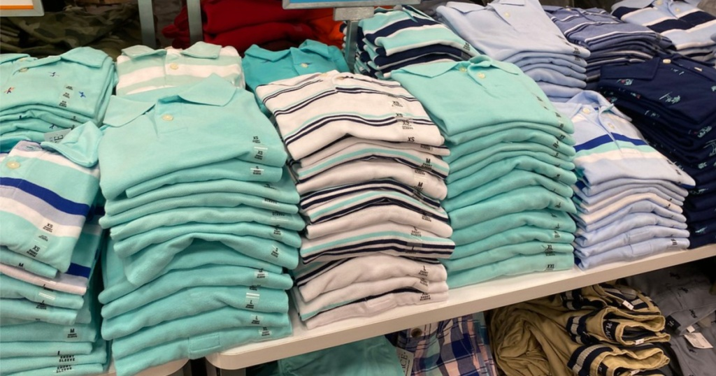 boys polos greens and blues on display in store