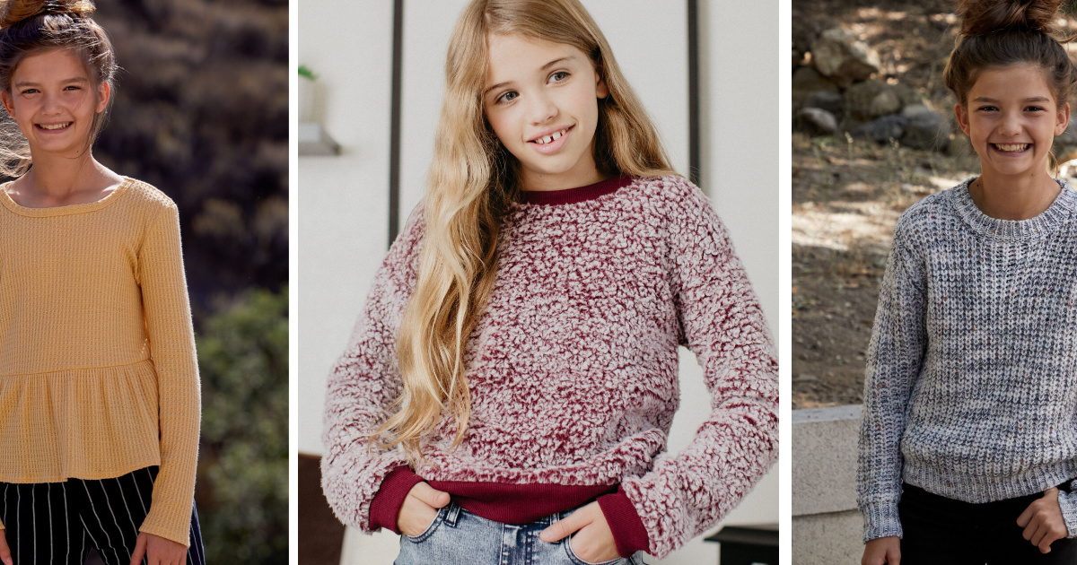 girls wearing yellow top, red fluffy sweater and grey sweater