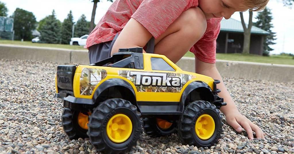 boy playing with tonka pickup truck