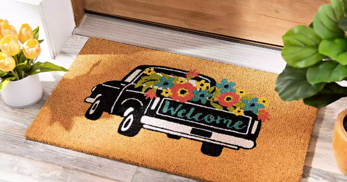 doormat of a truck with flowers by a front door
