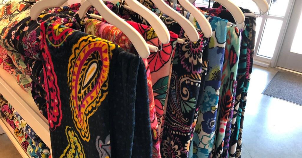 vera bradley throw blankets hanging on hangers
