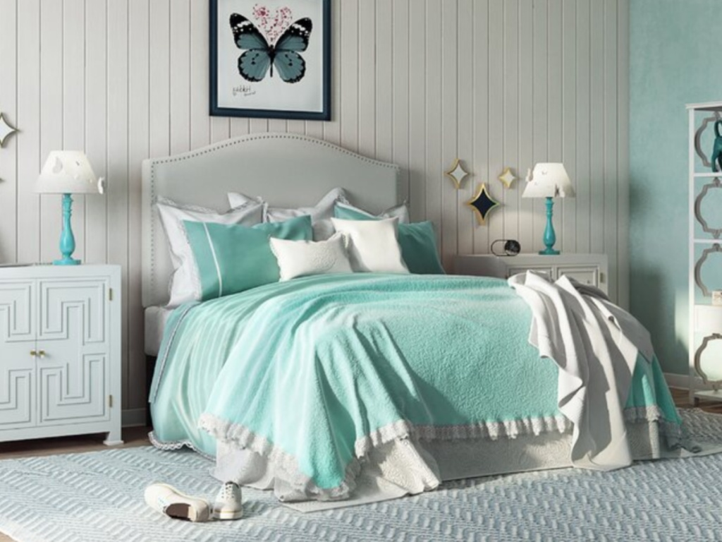 bedroom with white furniture and bed with white nail head headboard and blue comforter