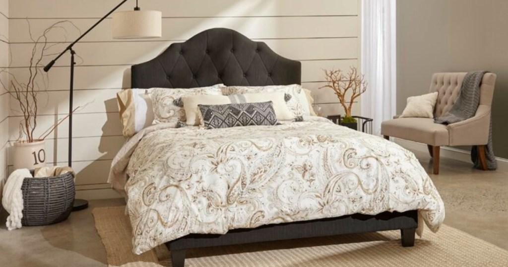 slate colored headboard and cream and tan comforter