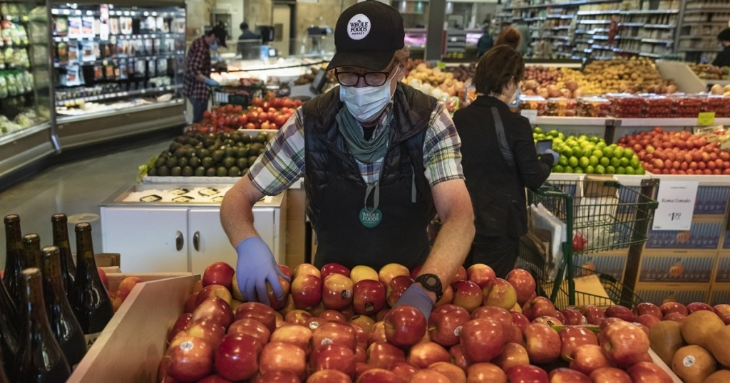 Whole Foods team member wearing mask
