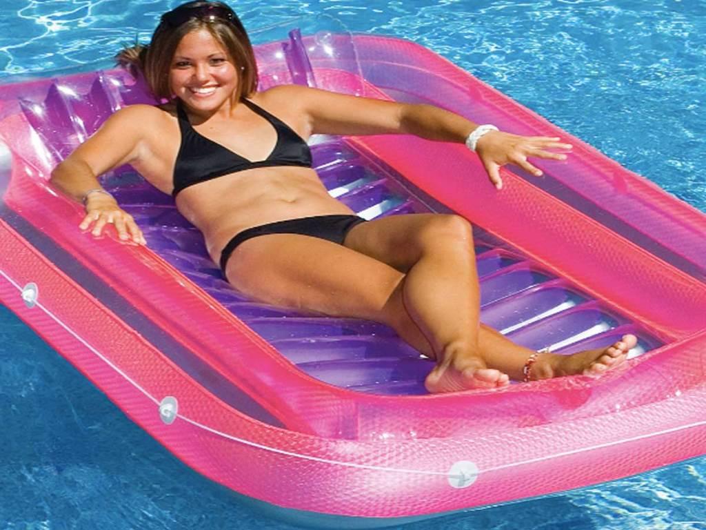 girl laying on a Swimline SunTan Tub
