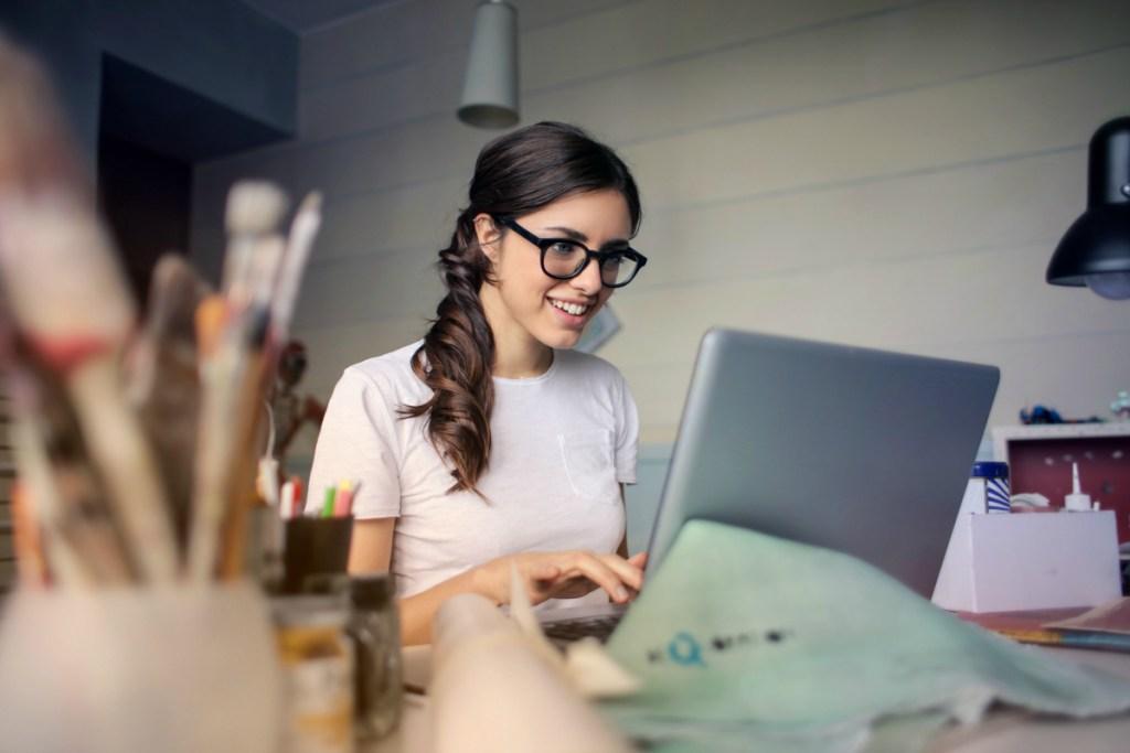 woman searching on laptop