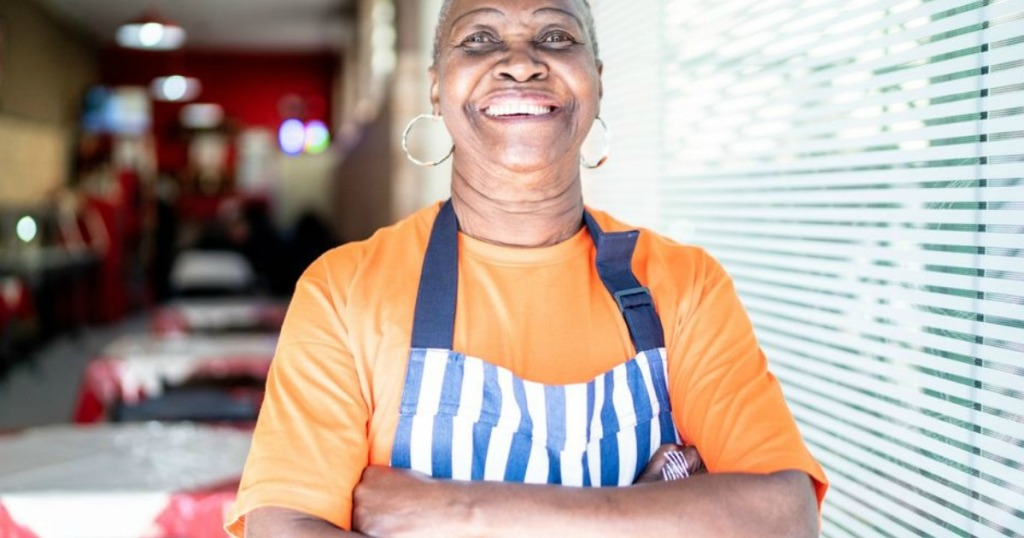 restaurant owner with apron on smiling