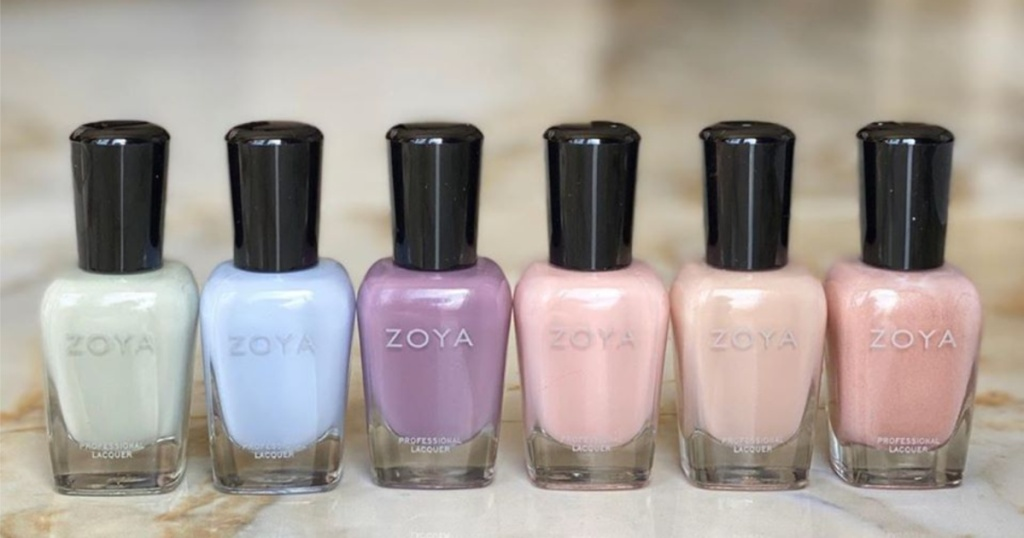 6 colorful ZOYA nail polishes displayed on marble counter