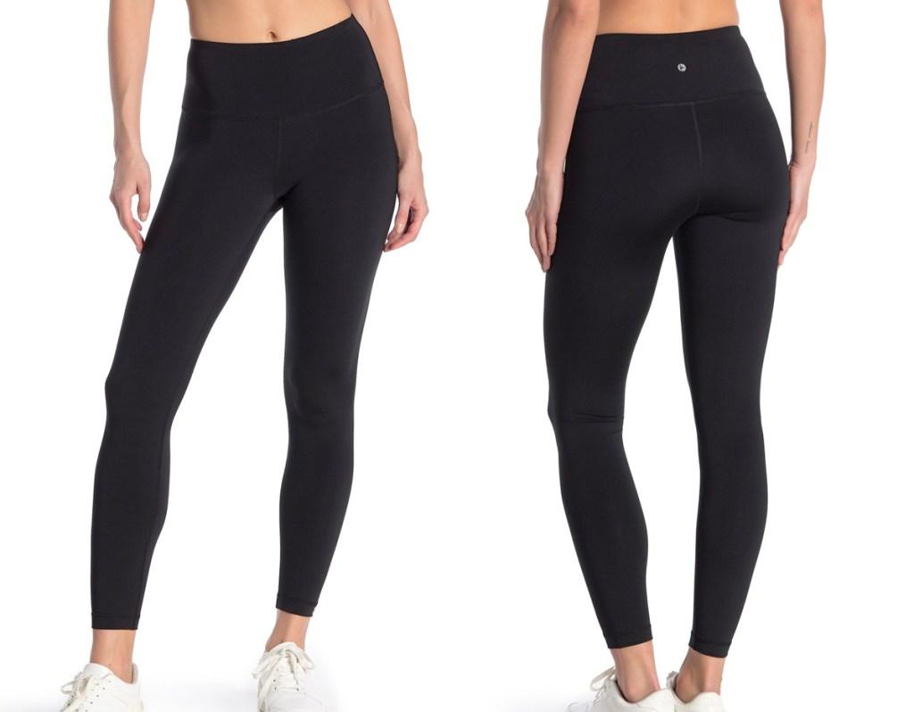 woman modeling pair of black high waisted leggings