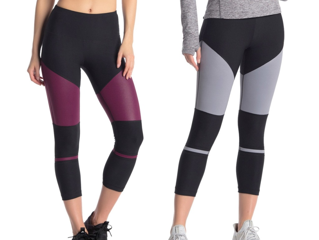 woman modeling two pairs of color block leggings in maroon & black and grey & black colors