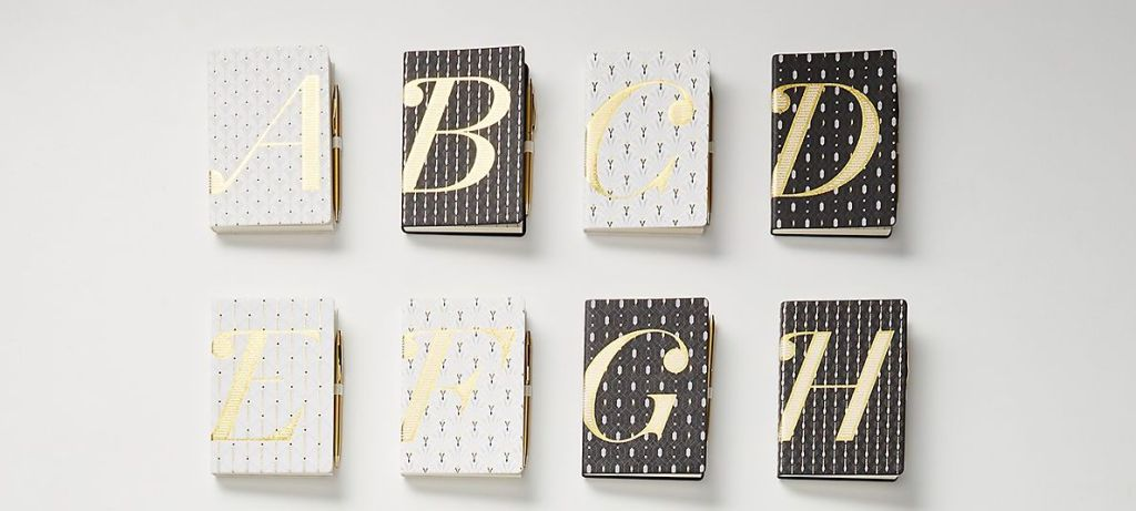 group of journals with monogram letters