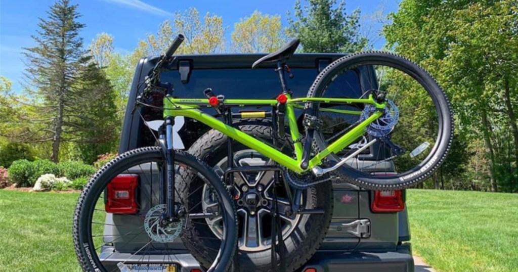 green back on tire bike rack on car