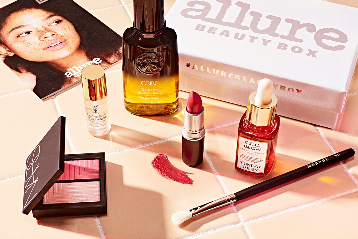 various beauty products and box on table