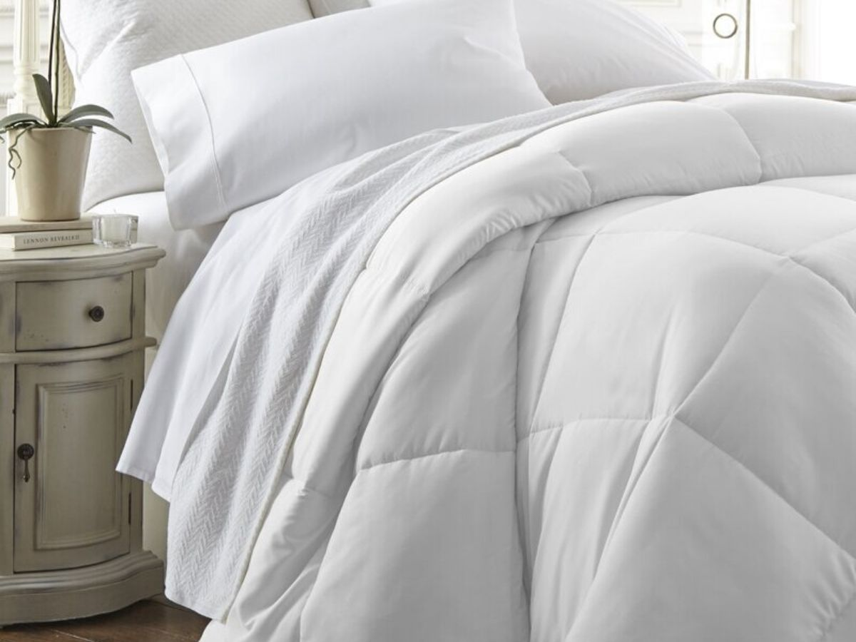 bed with down comforter