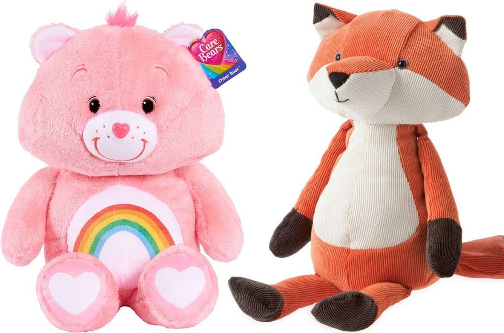 pink care bear with rainbow on tummy and fox stuffed animal