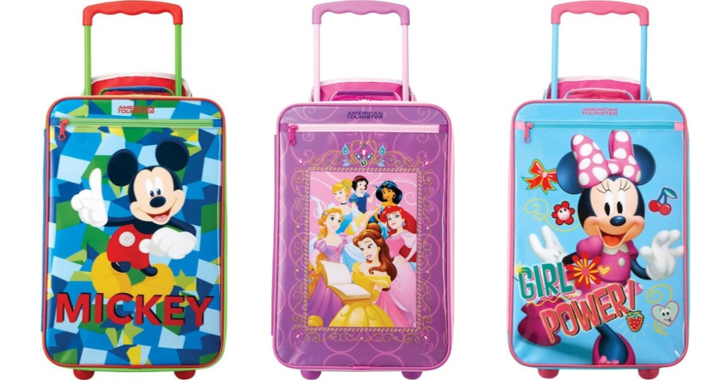 3 kids Disney suitcases lined up next to each other